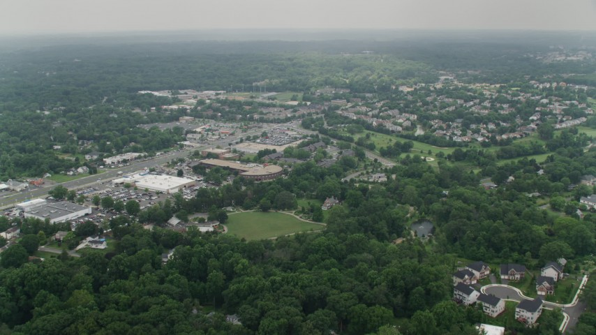 5K stock footage aerial video approaching shops near homes on Little River Turnpike in Alexandria, Virginia Aerial Stock Footage | AX74_126