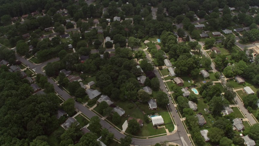 5K stock footage aerial video tilting to a bird's eye view of a suburban neighborhood in Springfield, Virginia Aerial Stock Footage | AX74_133