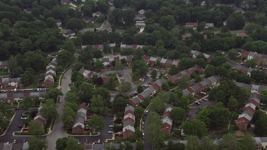 5K stock footage aerial video tilting to a bird's eye view of row houses in Springfield, Virginia Aerial Stock Footage | AX74_134