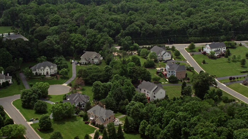5K stock footage aerial video flying over beautiful homes in Fairfax Station, Virginia  Aerial Stock Footage | AX74_140