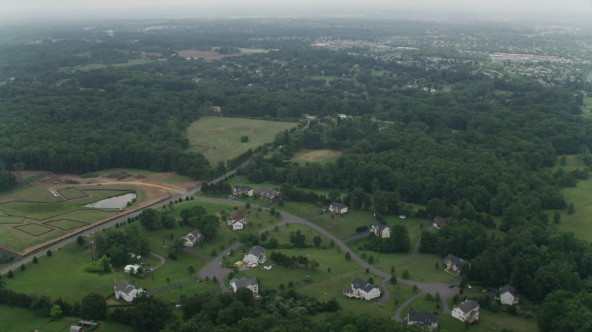 5K stock footage aerial video flying over rural homes around Signal Hill Road in Manassas, Virginia Aerial Stock Footage | AX74_147