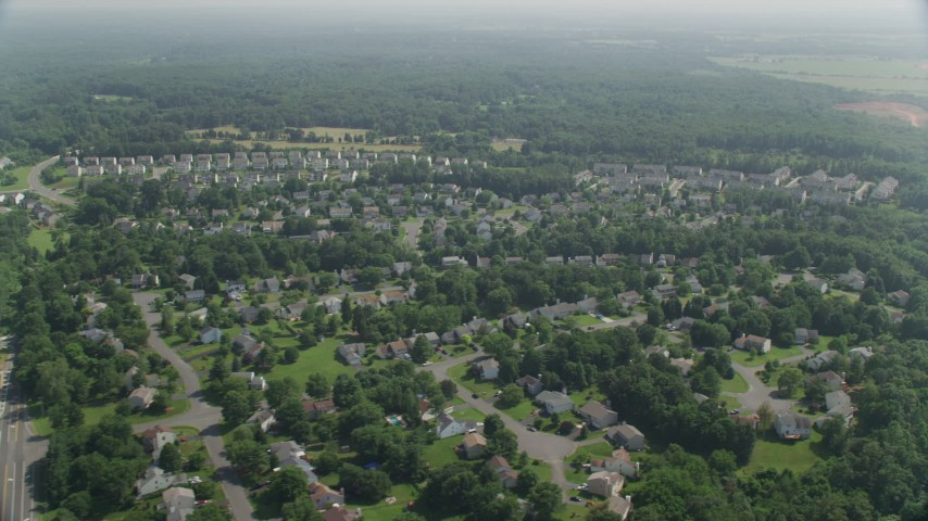 5K stock footage aerial video flying by suburban neighborhoods, Manassas, Virginia  Aerial Stock Footage   AX75_001