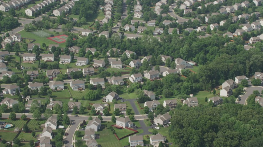 5K stock footage aerial video flying by neighborhood with white homes in Manassas, Virginia Aerial Stock Footage | AX75_005