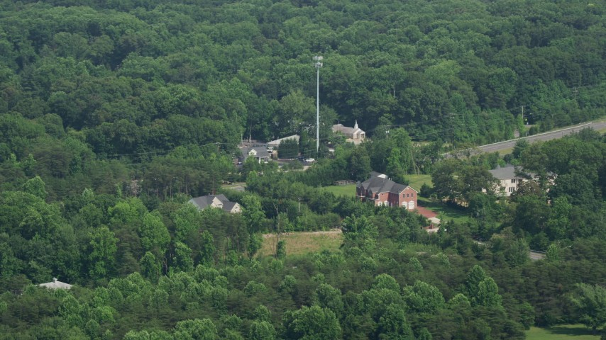 5K stock footage aerial video of small rural churches and homes by Ox Road in Fairfax Station, Virginia Aerial Stock Footage | AX75_014