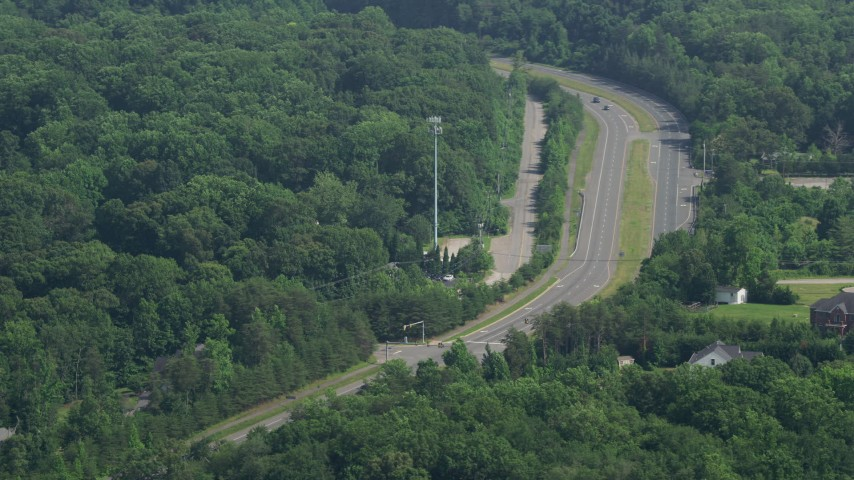 5K stock footage aerial video of light traffic on Ox Road in Fairfax Station, Virginia Aerial Stock Footage | AX75_015