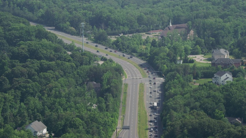 5K stock footage aerial video of light traffic passing a church by Ox Road in Fairfax Station, Virginia Aerial Stock Footage AX75_016 | Axiom Images