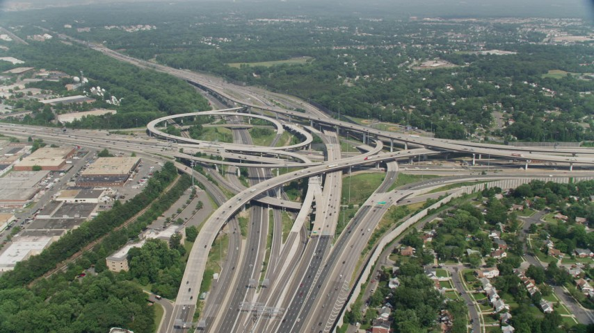 5K stock footage aerial video approaching the I-495 / I-395 freeway interchange with light traffic in Springfield, Virginia Aerial Stock Footage | AX75_026