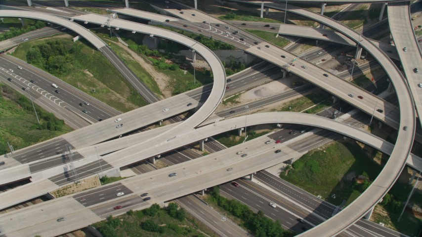 5K stock footage aerial video tracking cars on the I-495 and I-395 freeway  interchange in Springfield, Virginia