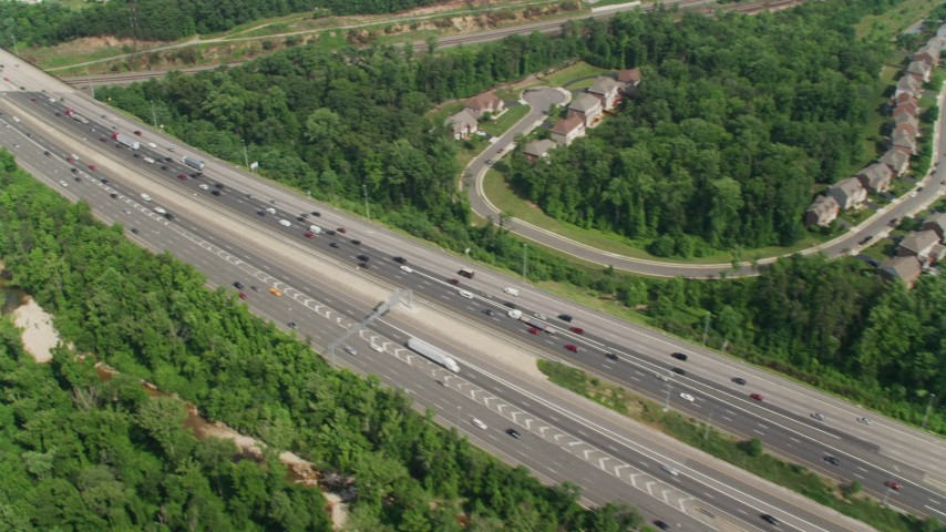 5K aerial video of light traffic on Interstate 95 through Alexandria, Virginia Aerial Stock Footage | AX75_028
