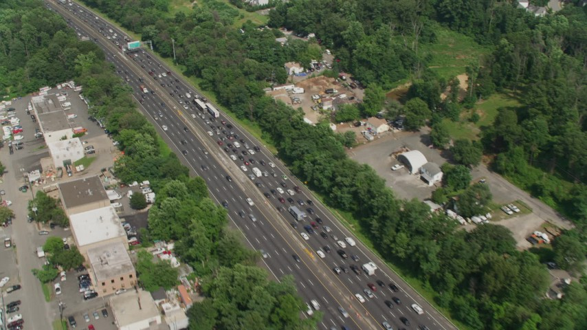 5K stock footage aerial video flying by heavy traffic on Interstate 95 in Alexandria, Virginia Aerial Stock Footage | AX75_031
