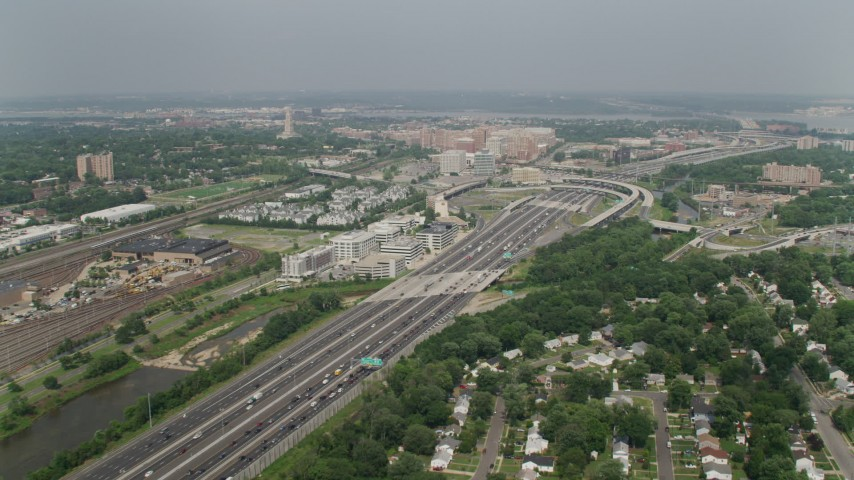 5K stock footage aerial video passing heavy traffic on Interstate 95 by the train yard and office buildings Alexandria, Virginia Aerial Stock Footage | AX75_034