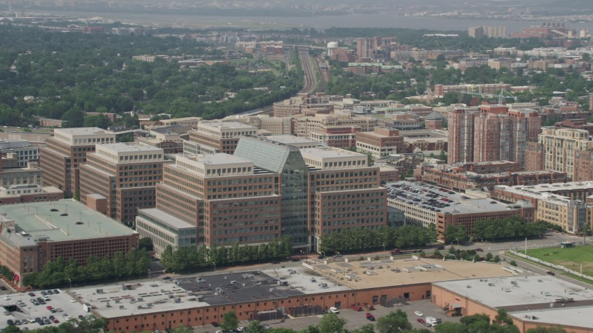 5K stock footage aerial video flying by the United States Patent and Trademark Office and office buildings in Alexandria, Virginia Aerial Stock Footage | AX75_036