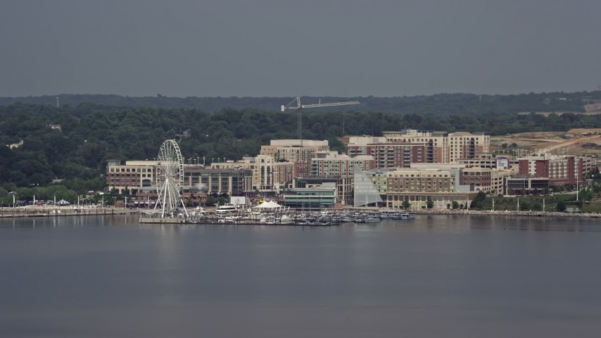 5K aerial video approaching marina and Capitol Wheel at National Harbor, Maryland Aerial Stock Footage | AX75_039