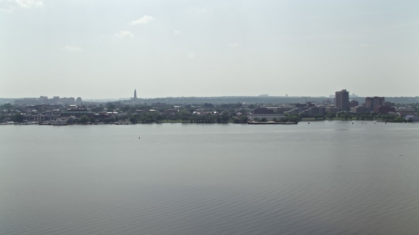 5K aerial video of office buildings across the Potomac River in Alexandria, Virginia Aerial Stock Footage | AX75_043