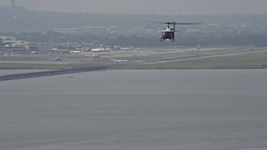5K stock footage aerial video of a helicopter flying over the Potomac River near Alexandria, Virginia Aerial Stock Footage | AX75_044