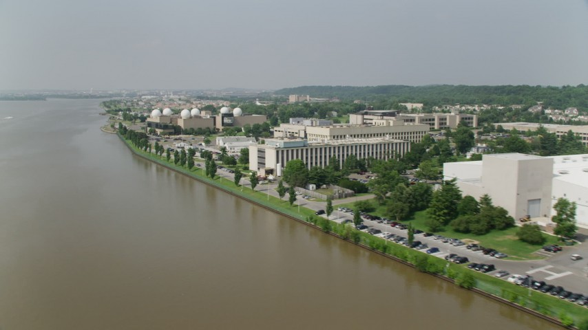 5K stock footage aerial video flying by the United States Naval Research Laboratory in Washington DC Aerial Stock Footage   AX75_045