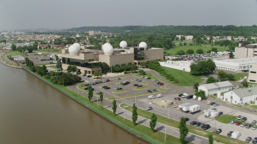 5K stock footage aerial video flying by a building with radomes at United States Naval Research Laboratory in Washington DC Aerial Stock Footage | AX75_046