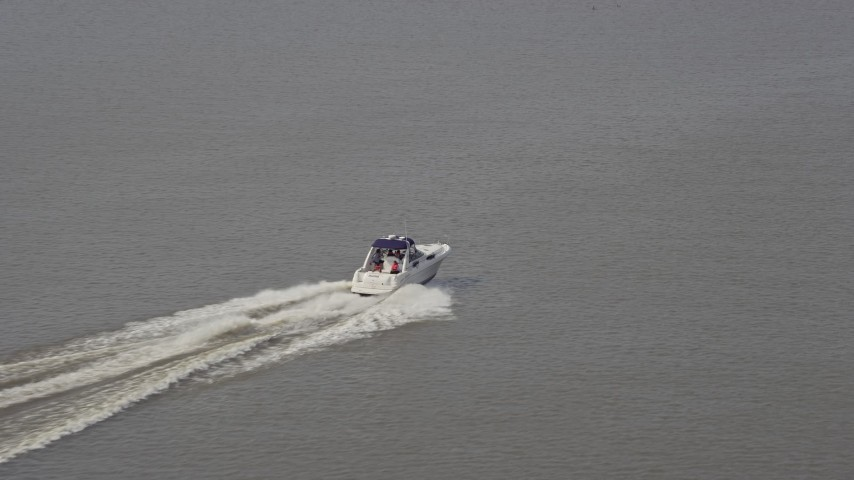 5K stock footage aerial video tracking a speedboat cruising on the Potomac River in Washington DC Aerial Stock Footage | AX75_047