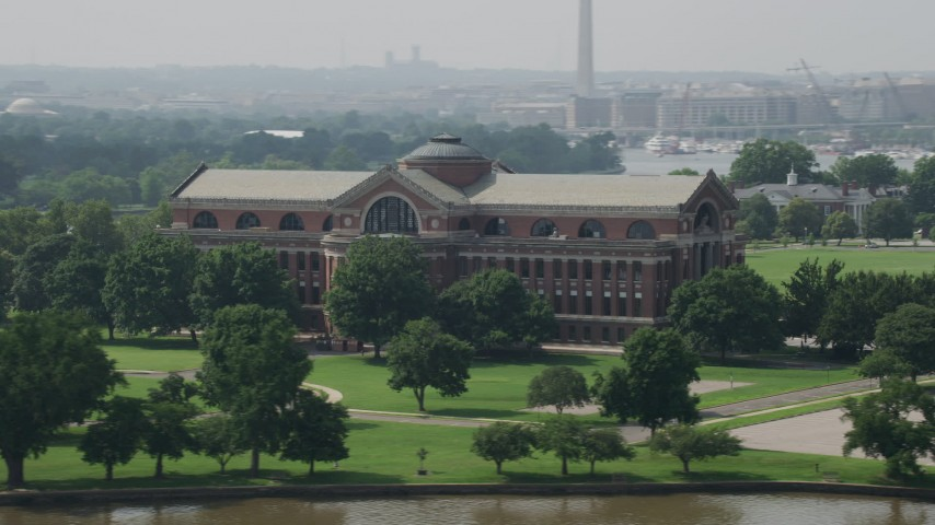 5K stock footage aerial video flying by Roosevelt Hall, Home to the National War College in Washington DC Aerial Stock Footage | AX75_050