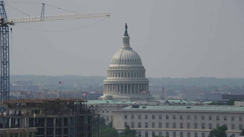 5K stock footage aerial video of the United States Capitol dome in Washington DC, and reveal smoke stacks Aerial Stock Footage | AX75_054