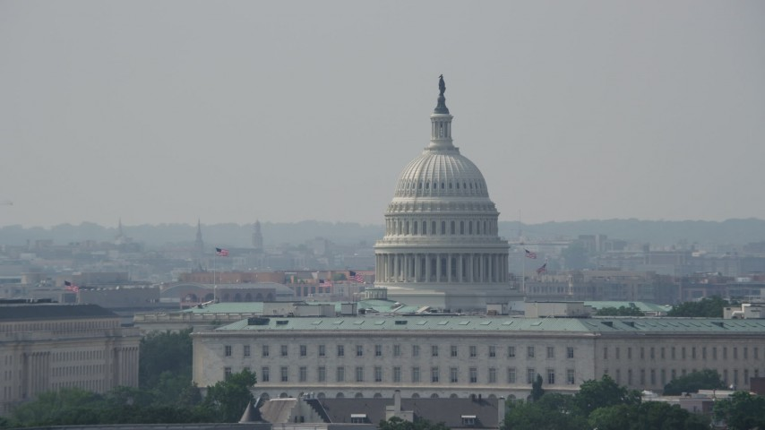 5K stock footage aerial video of United States Capitol dome and top of the Cannon House Office Building in Washington DC Aerial Stock Footage | AX75_055