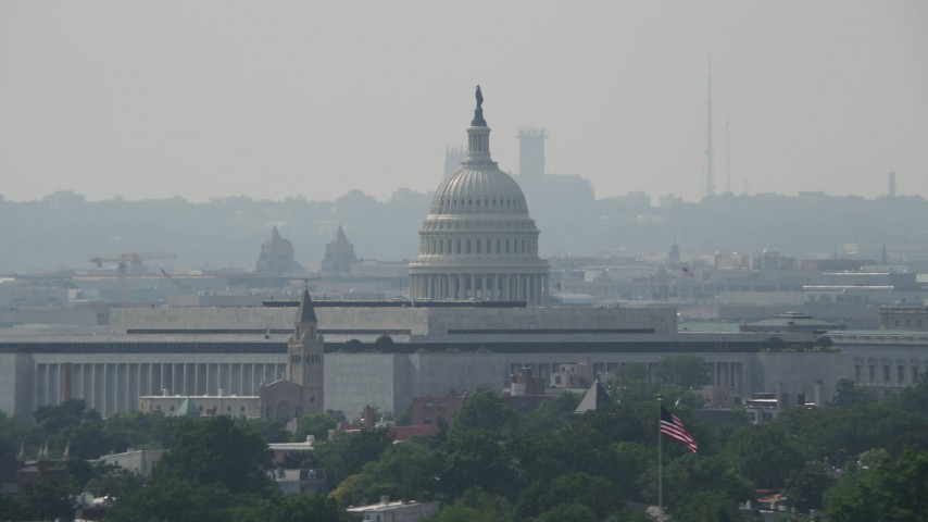 5K stock footage aerial video of the United States Capitol dome with James Madison Building in foreground in Washington DC Aerial Stock Footage | AX75_058
