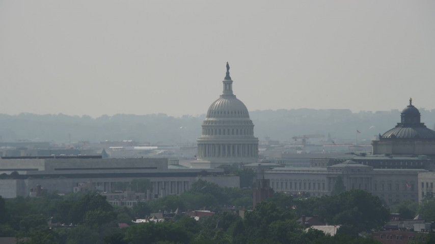 5K stock footage aerial video of the United States Capitol Dome between the James Madison and Thomas Jefferson Buildings in Washington DC Aerial Stock Footage | AX75_059