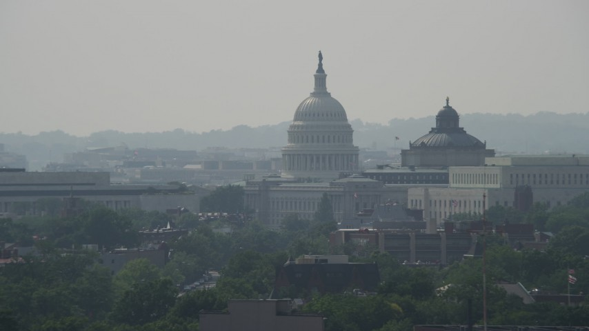 5K stock footage aerial video of the United States Capitol, and the Thomas Jefferson and John Adams Buildings in Washington DC Aerial Stock Footage | AX75_060