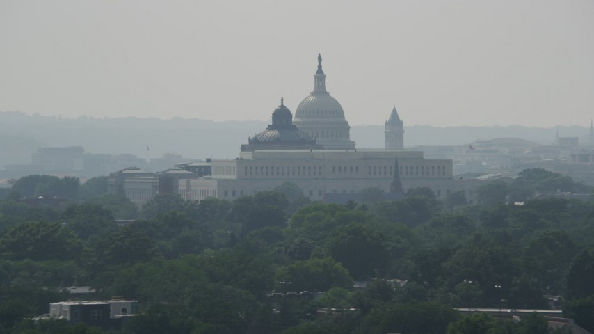 5K stock footage aerial video of the United States Capitol and the Thomas Jefferson Building domes behind the John Adams Building in Washington DC Aerial Stock Footage | AX75_062