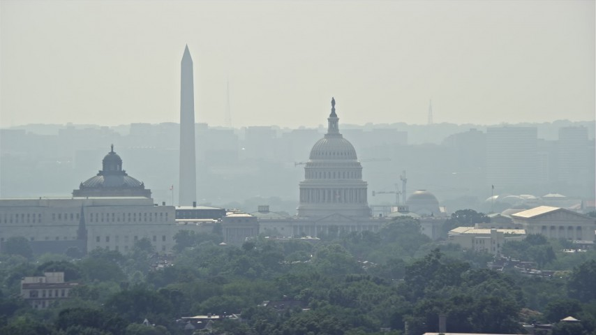 5K stock footage aerial video of the United States Capitol and the Thomas Jefferson Building domes behind the John Adams Building in Washington DC Aerial Stock Footage   AX75_062E