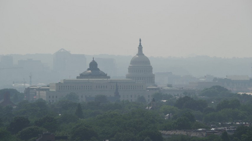 5K stock footage aerial video of United States Capitol and Library of Congress buildings, reveal Washington Monument in Washington DC Aerial Stock Footage | AX75_063