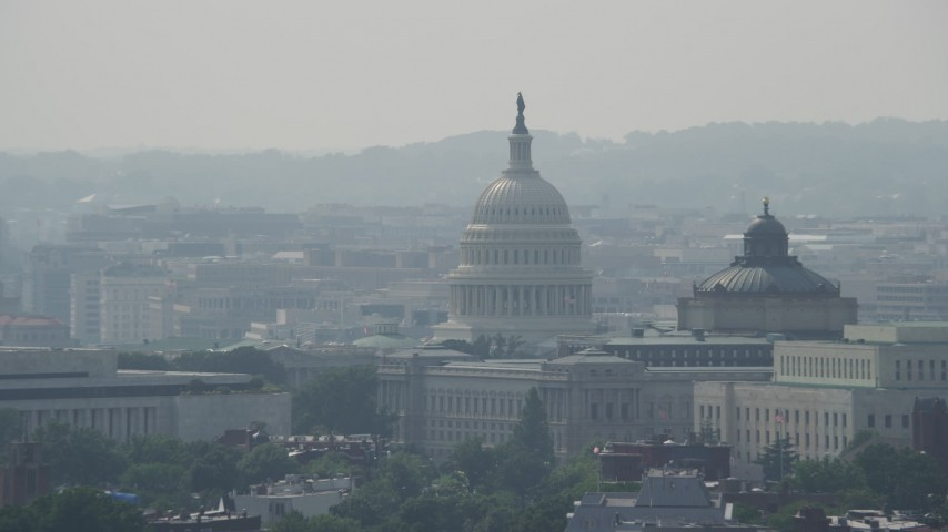5K stock footage aerial video of the United States Capitol and Thomas Jefferson Building domes in Washington DC Aerial Stock Footage | AX75_067