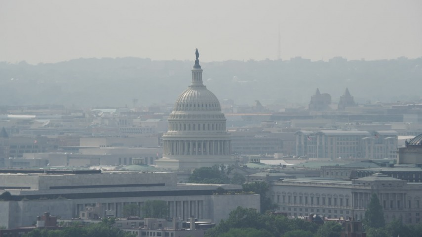 5K stock footage aerial video of United States Capitol Dome behind the James Madison Building in Washington DC Aerial Stock Footage | AX75_068