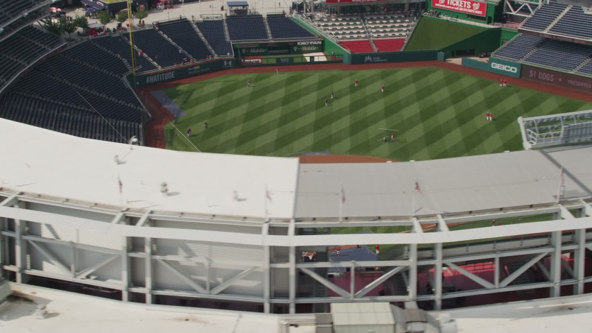 5K stock footage aerial video of baseball practice at Nationals Park Stadium in Washington DC Aerial Stock Footage | AX75_072