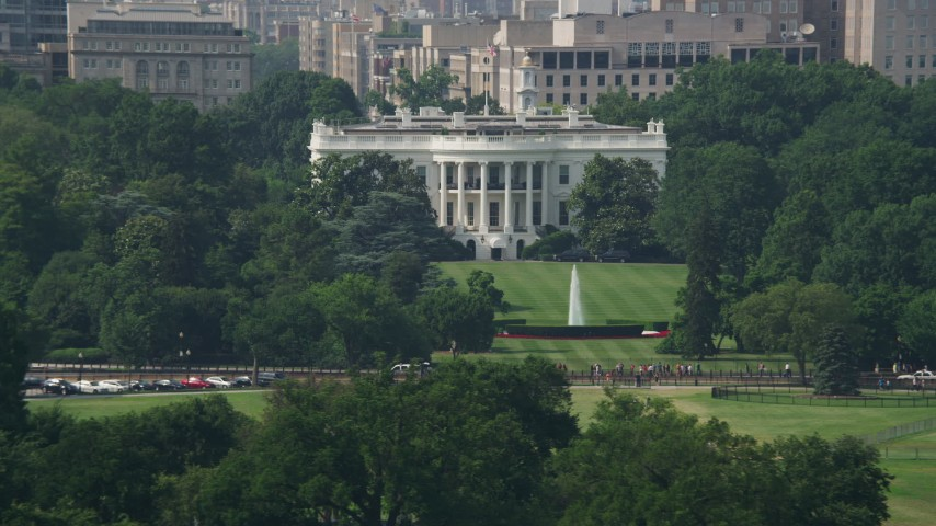 5K stock footage aerial video the White House and South Lawn, reveal part of Washington Monument in Washington DC Aerial Stock Footage | AX75_077