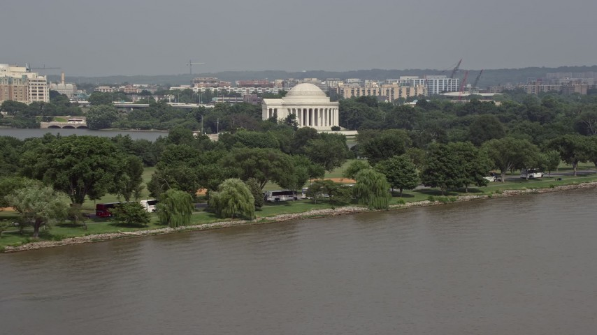 5K stock footage aerial video of Jefferson Memorial seen from the Potomac River in Washington DC Aerial Stock Footage | AX75_080