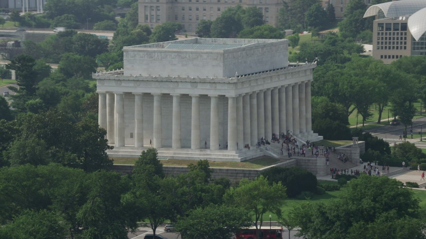 5K stock footage aerial video of Lincoln Memorial with Tourists on the Steps in Washington DC Aerial Stock Footage | AX75_089