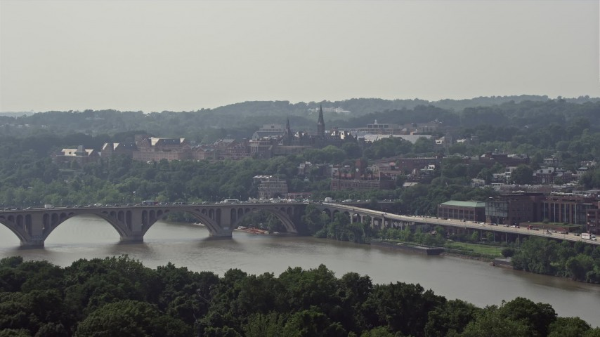 5K stock footage aerial video of Georgetown University and Francis Scott Key Bridge in Washington DC Aerial Stock Footage | AX75_091