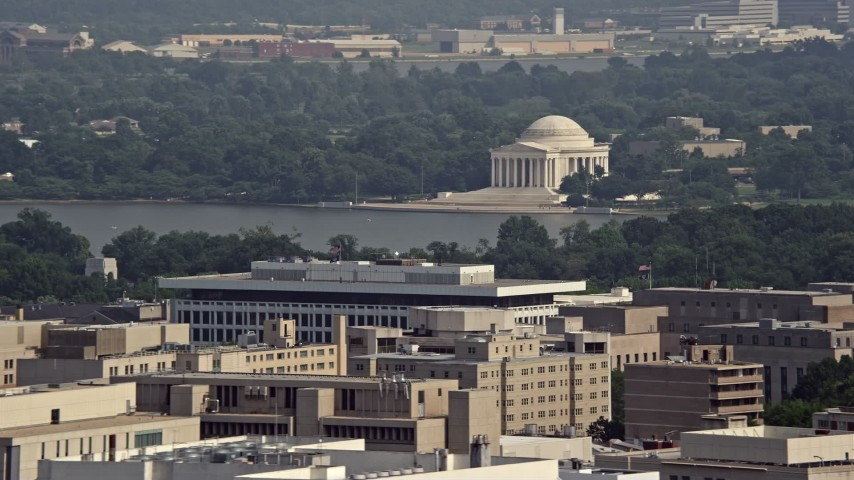 5K stock footage aerial video of the Jefferson Memorial seen from Georgetown, Washington DC Aerial Stock Footage | AX75_094