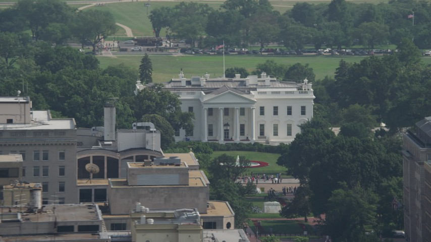 5K stock footage aerial video of the White House and North Lawn Fountain in Washington DC Aerial Stock Footage | AX75_097