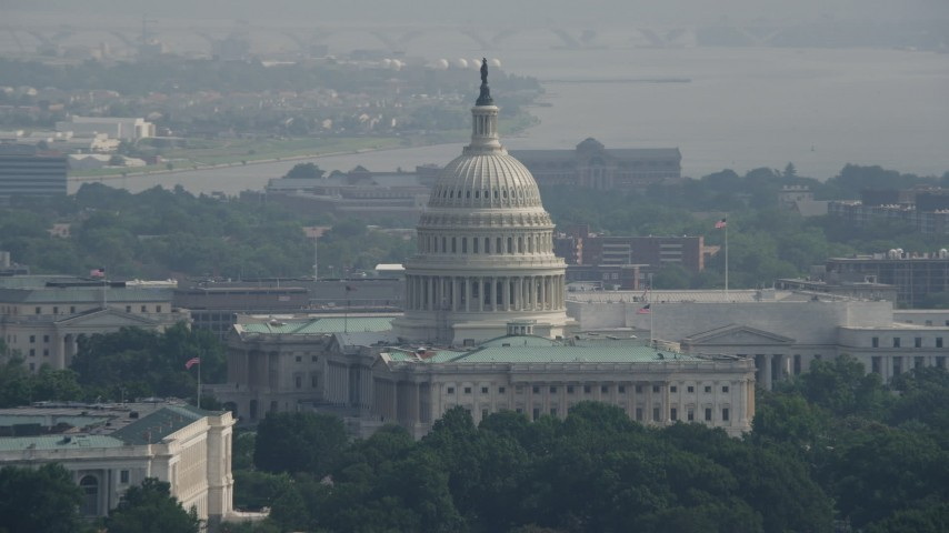 5K stock footage aerial video of United States Capitol Building and Dome in Washington DC Aerial Stock Footage | AX75_103