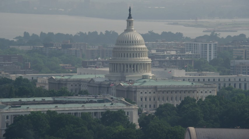 5K stock footage aerial video of the United States Capitol behind the Russell Senate Office Building in Washington DC Aerial Stock Footage | AX75_104