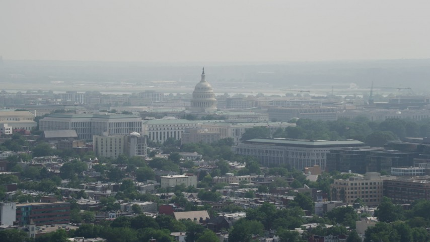 5K stock footage aerial video of the United States Capitol seen from across Washington DC Aerial Stock Footage | AX75_105