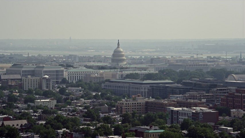 5K stock footage aerial video of the United States Capitol seen from across Washington DC Aerial Stock Footage | AX75_105E