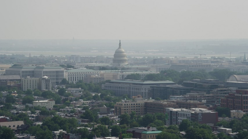 5K stock footage aerial video of the United States Capitol dome seen from across Washington DC Aerial Stock Footage | AX75_106