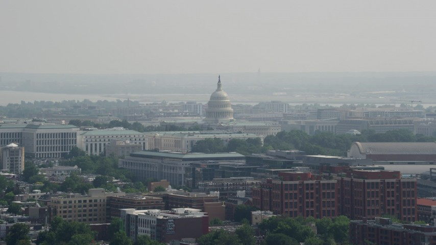 5K stock footage aerial video of the United States Capitol dome and Washington DC government buildings Aerial Stock Footage | AX75_107