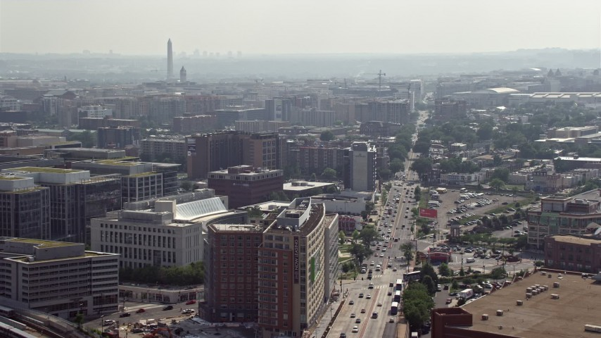 5K stock footage aerial video office buildings on New York Ave with Washington Monument in distance in Washington DC Aerial Stock Footage | AX75_108