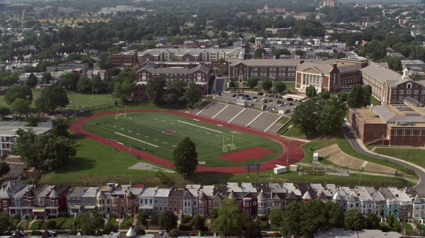 5K stock footage aerial video of McKinley Technology High School and football field in Washington DC Aerial Stock Footage | AX75_109
