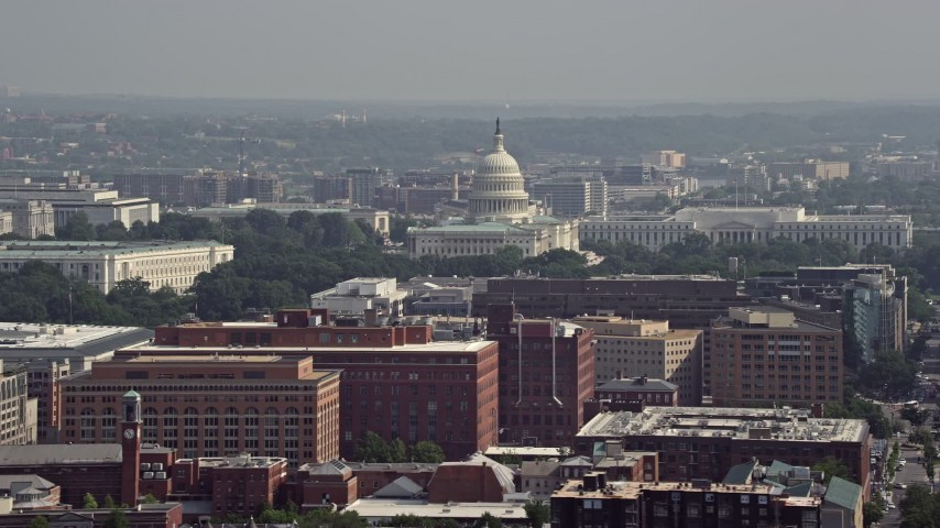 5K aerial video of office buildings, the United States Capitol, and the Rayburn House Office Building in Washington DC Aerial Stock Footage | AX75_110
