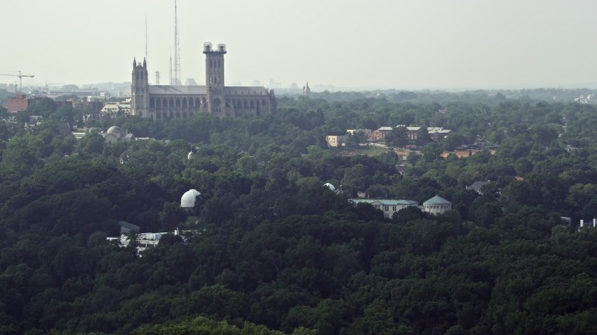 5K stock footage aerial video of the Washington National Cathedral,  Beauvoir Elementary School, and the United States Naval Observatory in  Washington
